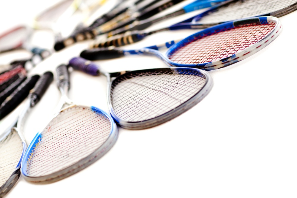 Squash rackets - isolated over a white background.jpeg