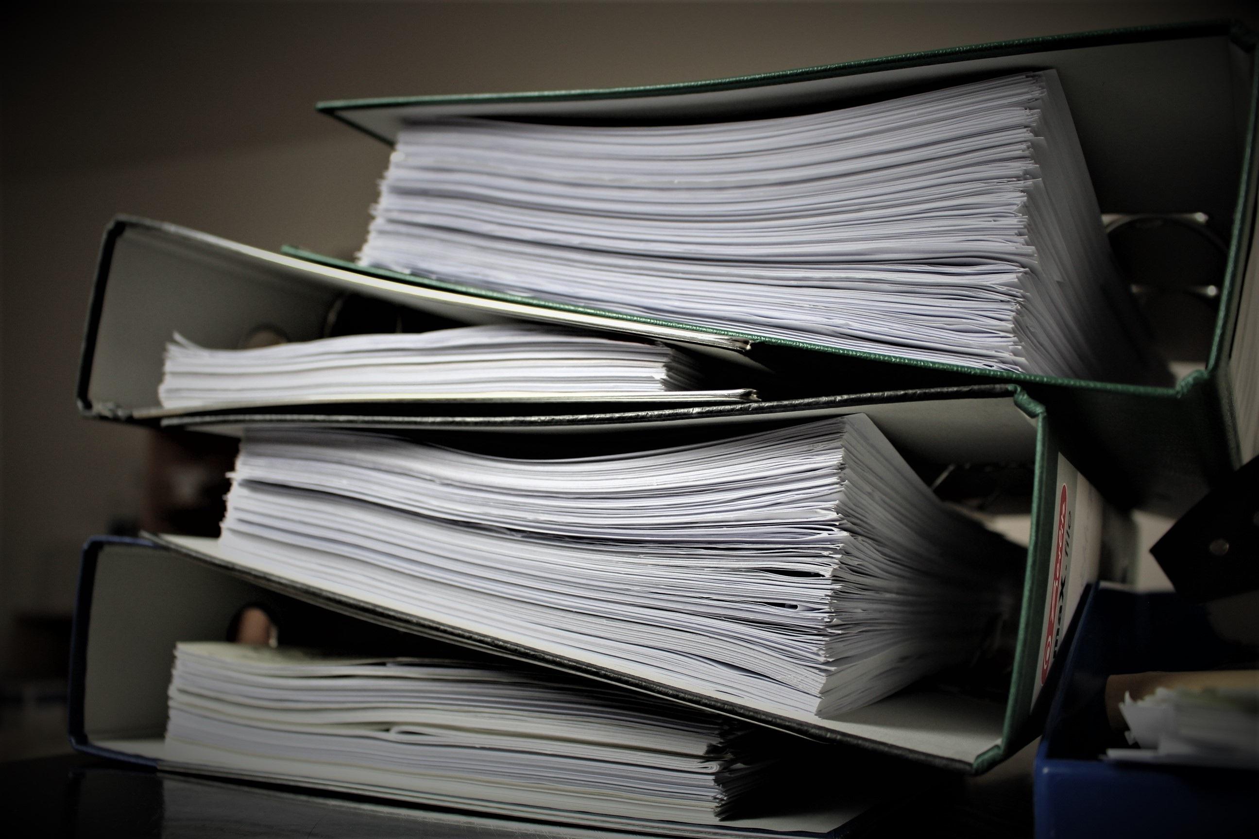Canva - Pile of Folders
