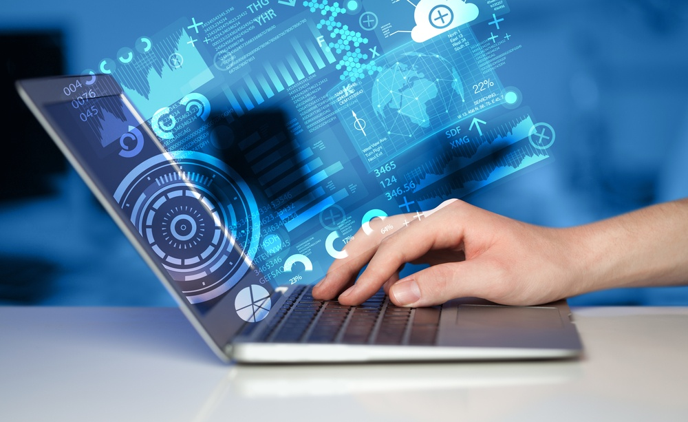 Modern notebook computer with future technology media symbols.jpeg